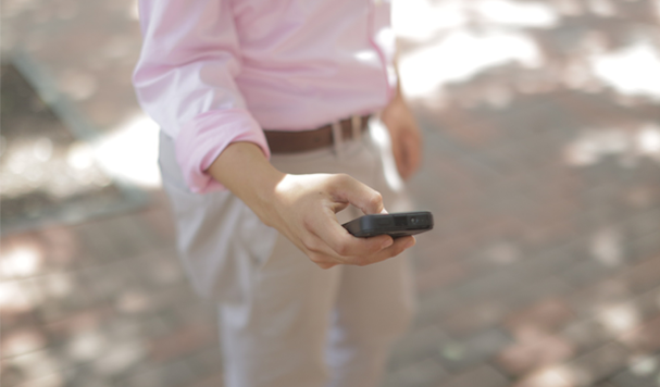 Man on cell phone cultivating a collaborative workforce